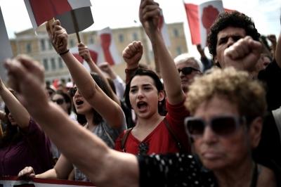 Афина. Члены All-Werkers Militant Front протестуют.